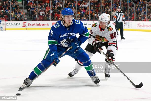 Brandon Saad of the Chicago Blackhawks checks Brock Boeser of the Vancouver Canucks during their NHL game at Rogers Arena February 2 2018 in...
