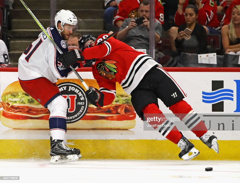 Brandon Saad #20 of the Chicago Blackhawks collides with Jacob Graves #51 of the Columbus Blue Jackets during a preseason game at the United Center on September 23, 2017 in Chicago, Illinois. The Blue Jackets defeated the Blackhawks 3-2.