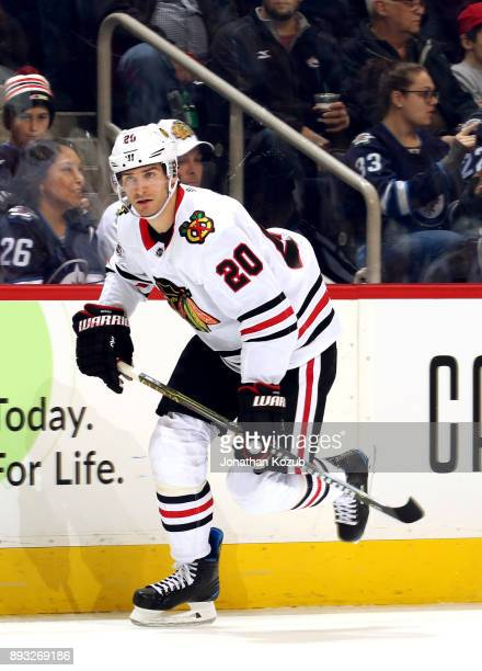 Brandon Saad of the Chicago Blackhawks follows the play down the ice during third period action against the Winnipeg Jets at the Bell MTS Place on...