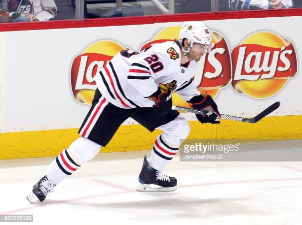 Brandon Saad of the Chicago Blackhawks keeps an eye on the play during third period action against the Winnipeg Jets at the Bell MTS Place on March...
