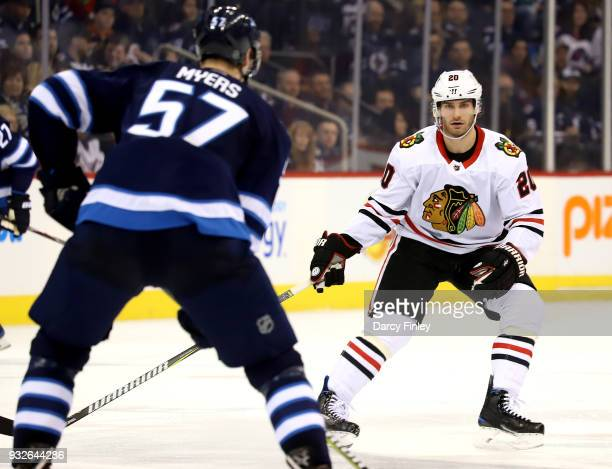 Brandon Saad of the Chicago Blackhawks keeps an eye on Tyler Myers of the Winnipeg Jets during third period action at the Bell MTS Place on March 15...