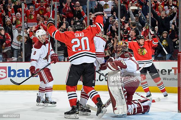 Brandon Saad of the Chicago Blackhawks reacts next to goalie Mike Smith of the Arizona Coyotes as Marian Hossa celebrates in the background after...