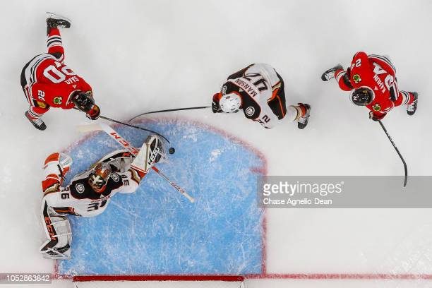 Brandon Saad of the Chicago Blackhawks scores on goalie John Gibson of the Anaheim Ducks in the first period at the United Center on October 23 2018...