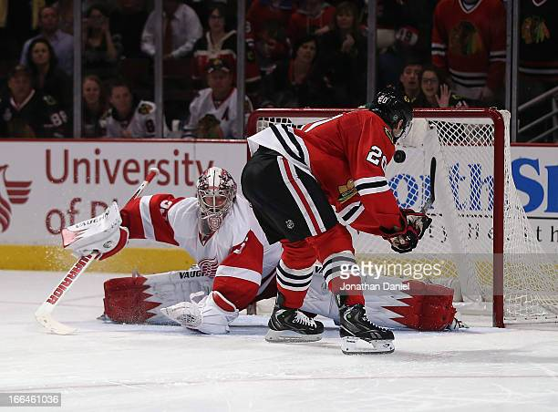 Brandon Saad of the Chicago Blackhawks scores the gamewinning goal in a shootout against Jimmy Howard of the Detroit Red Wings at the United Center...