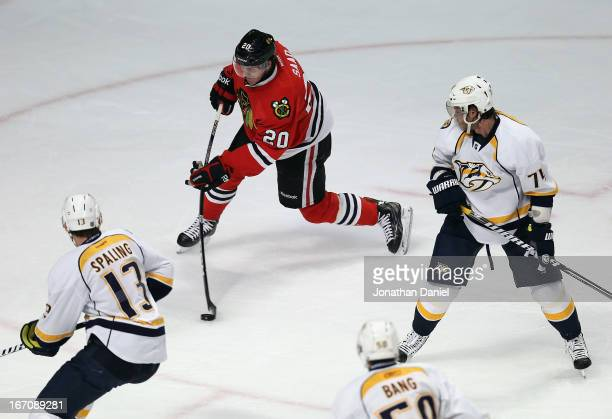Brandon Saad of the Chicago Blackhawks shoots and scores a goal surrounded by Nick Spaling Daniel Bang and Sergei Kostitsyn of the Nashville...