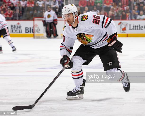 Brandon Saad of the Chicago Blackhawks skates up ice against the Detroit Red Wings during an NHL game at Little Caesars Arena on March 6, 2020 in...