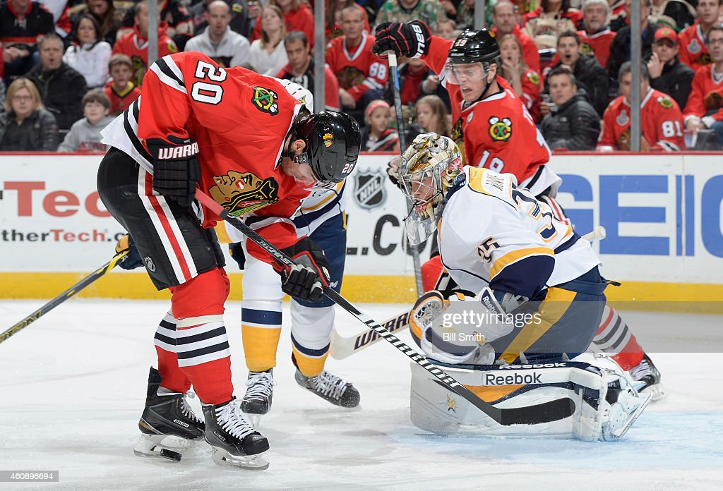 Brandon Saad #20 of the Chicago Blackhawks takes the puck toward goaile Pekka Rinne #35 of the Nashville Predators during the NHL game at the United Center on December 29, 2014 in Chicago, Illinois.