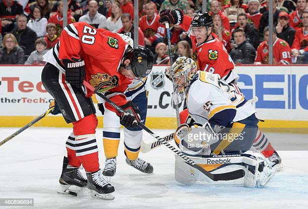 Brandon Saad of the Chicago Blackhawks takes the puck toward goaile Pekka Rinne of the Nashville Predators during the NHL game at the United Center...