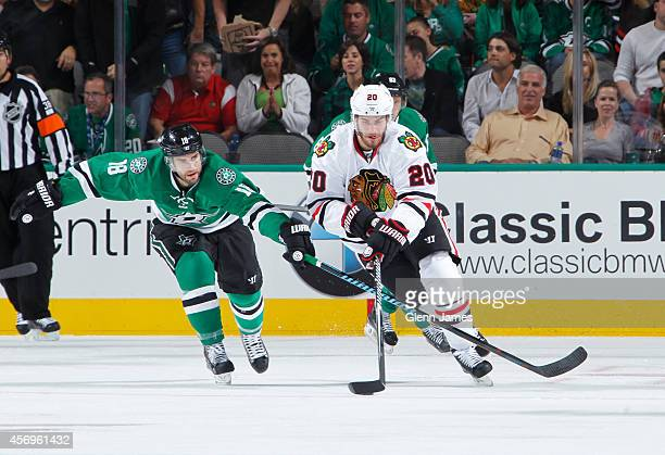Brandon Saad of the Chicago Blackhawks tries to keep the puck away against Patrick Eaves of the Dallas Stars at the American Airlines Center on...