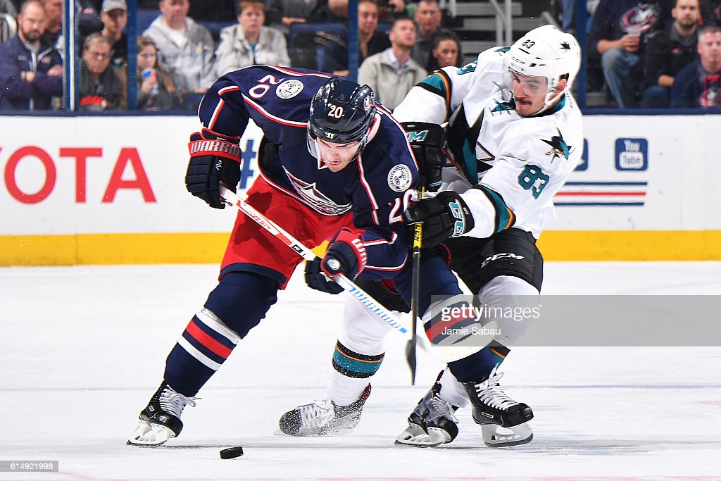 Brandon Saad #20 of the Columbus Blue Jackets battles to shield Matt Nieto #83 of the San Jose Sharks from the puck during the third period of a game on October 15, 2016 at Nationwide Arena in Columbus, Ohio. San Jose defeated Columbus 3-2.