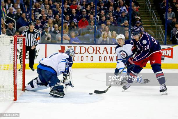 Brandon Saad of the Columbus Blue Jackets beats Eric Comrie of the Winnipeg Jets for a goal during the game on April 6 2017 at Nationwide Arena in...
