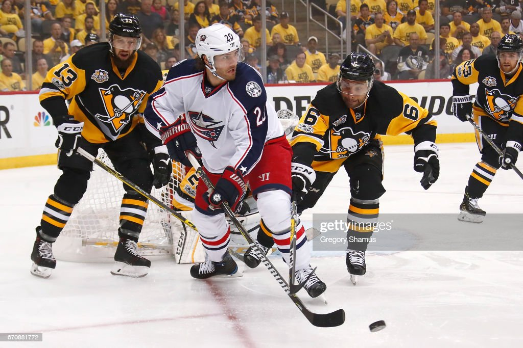 Brandon Saad #20 of the Columbus Blue Jackets controls the puck in front of Trevor Daley #6 of the Pittsburgh Penguins during the first period in Game Five of the Eastern Conference First Round during the 2017 NHL Stanley Cup Playoffs at PPG Paints Arena on April 20, 2017 in Pittsburgh, Pennsylvania.