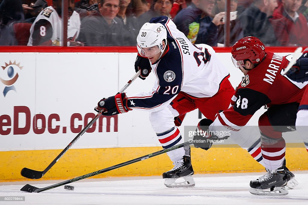 Brandon Saad #20 of the Columbus Blue Jackets skates after the puck with Jordan Martinook #48 of the Arizona Coyotes during the NHL game at Gila River Arena on December 17, 2015 in Glendale, Arizona. The Blue Jackets defeated the Coyotes 7-5.