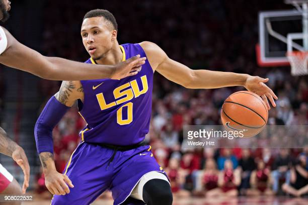 Brandon Sampson of the LSU Tigers dribbles down the court during a game against the Arkansas Razorbacks at Bud Walton Arena on January 10 2018 in...