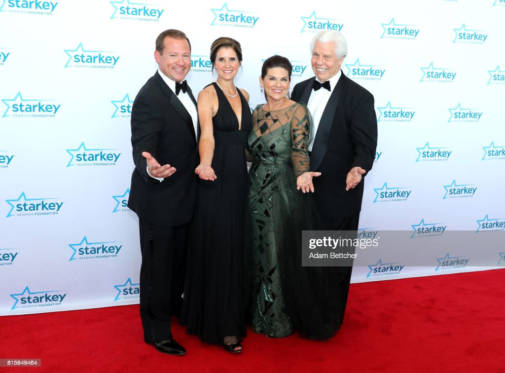 Brandon Sawalich, Stacy Sawalich, Tani Austin, and Bill Austin pose on the red carpet at the 2017 Starkey Hearing Foundation So the World May Hear Awards Gala at the Saint Paul RiverCentre on July 16, 2017 in St. Paul, Minnesota.
