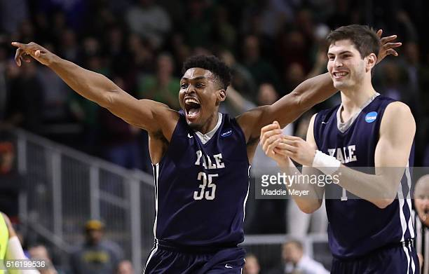 Brandon Sherrod of the Yale Bulldogs and Anthony Dallier celebrate defeating the Baylor Bears 79-75 during the first round of the 2016 NCAA Men's...