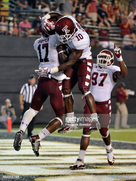Brandon Shippen of the Temple Owls is congratulated by teammates Khalif Herbin and Wanemi Omuso after scoring a touchdown against the Vanderbilt...