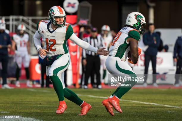 Brandon Silvers of the Seattle Dragons hands the ball off to Ja'Quan Gardner during the second half of the XFL game against the DC Defenders at Audi...