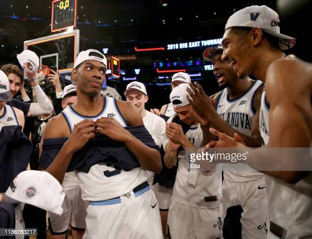 Brandon Slater of the Villanova Wildcats celebrates with Jahvon Quinerly and Jermaine Samuels after the 7472 win over the Seton Hall Pirates during...