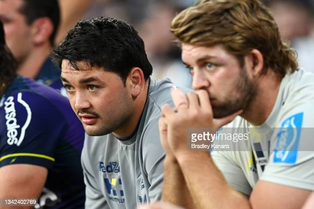 Brandon Smith and Christian Welch of the Storm watch on from the bench during the NRL Preliminary Final match between the Melbourne Storm and the...