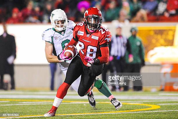 Brandon Smith of the Calgary Stampeders runs with the ball after intercepting it from the Saskatchewan Roughriders during a CFL game at McMahon...