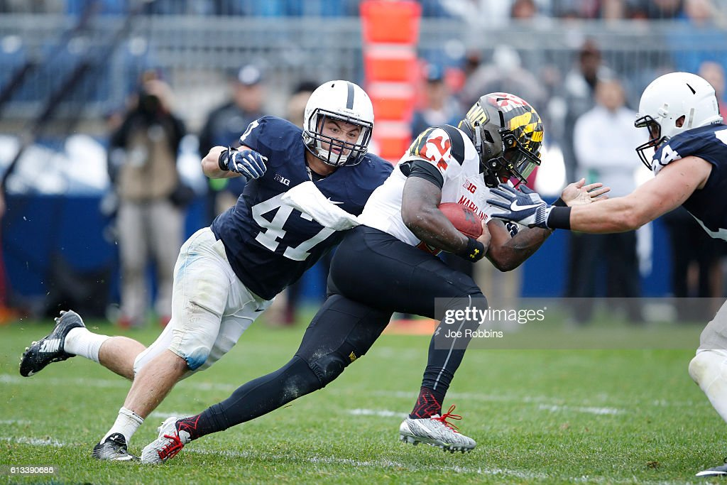 Brandon Smith #47 of the Penn State Nittany Lions reaches to tackle Tyrrell Pigrome #3 of the Maryland Terrapins in the second half at Beaver Stadium on October 8, 2016 in State College, Pennsylvania. Penn State defeated Maryland 38-14.