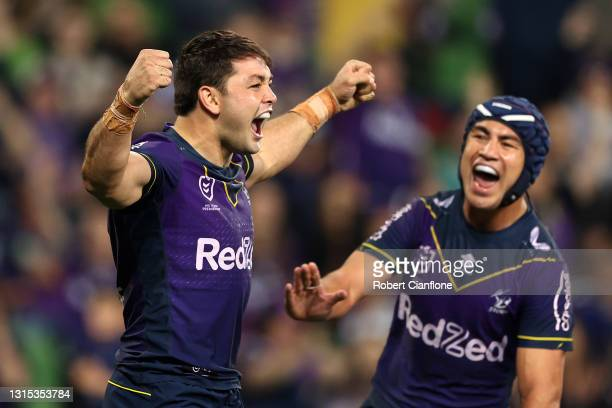 Brandon Smith of the Storm celebrates with team mates after scoring a try during the round eight NRL match between the Melbourne Storm and the...
