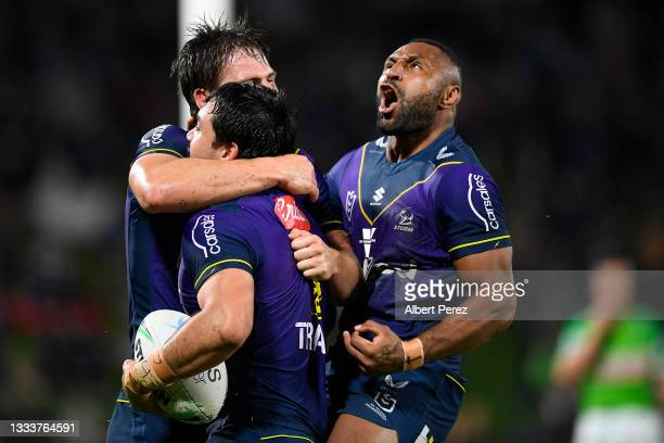 Brandon Smith of the Storm celebrates with team mates after scoring a try during the round 22 NRL match between the Melbourne Storm and the Canberra...
