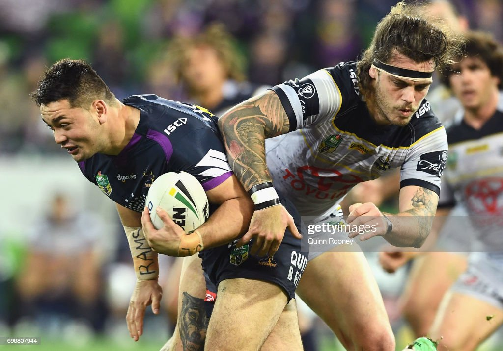 Brandon Smith of the Storm is tackled by Ethan Lowe of the Cowboys during the round 15 NRL match between the Melbourne Storm and the North Queensland Cowbpys at AAMI Park on June 17, 2017 in Melbourne, Australia.