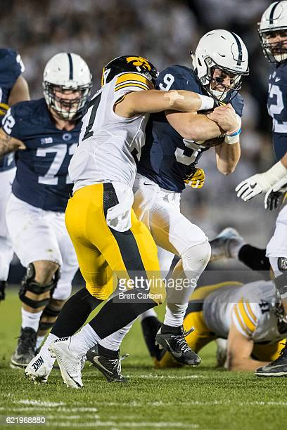 Brandon Snyder of the Iowa Hawkeyes tackles Trace McSorley of the Penn State Nittany Lions as he carries the ball during the first quarter against...