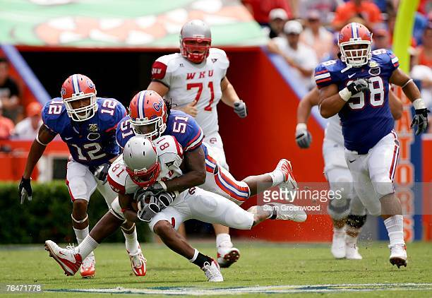 Brandon Spikes the Florida Gators tackles Jessie Quinn of the Western Kentucky Hilltoppers on September 1 2007 at Ben Hill Griffin Stadium in...
