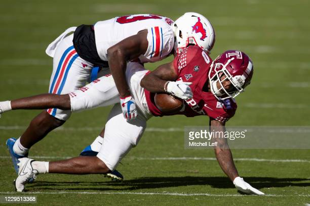 Brandon Stephens of the Southern Methodist Mustangs breaks up a pass intended for Randle Jones of the Temple Owls in the first quarter at Lincoln...