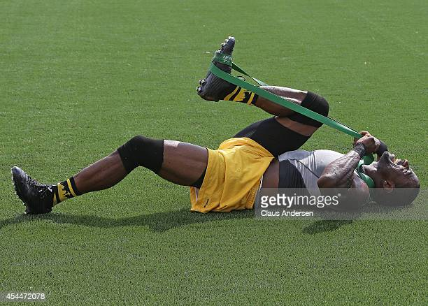 Brandon Stewart of the Hamilton Tigercats stretches prior to play between the Toronto Argonauts and Hamilton Tigercats in a CFL football game at Tim...