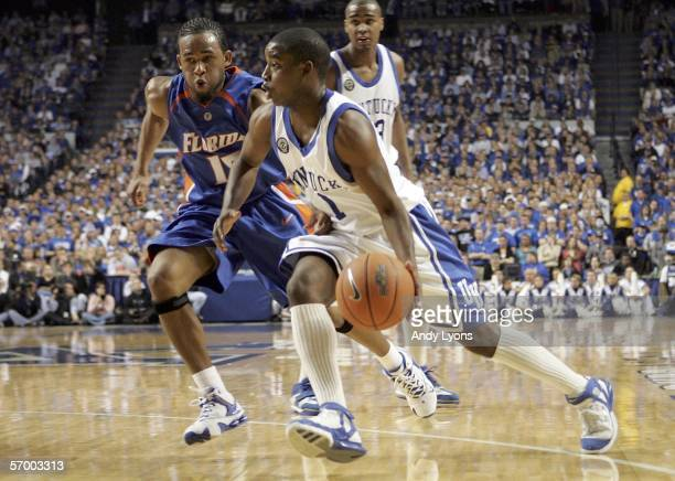 Brandon Stockton of the Kentucky Wildcats dribbles the ball while defended by Walter Hodge of the Florida Gators during the Gators 79-64 win on March...