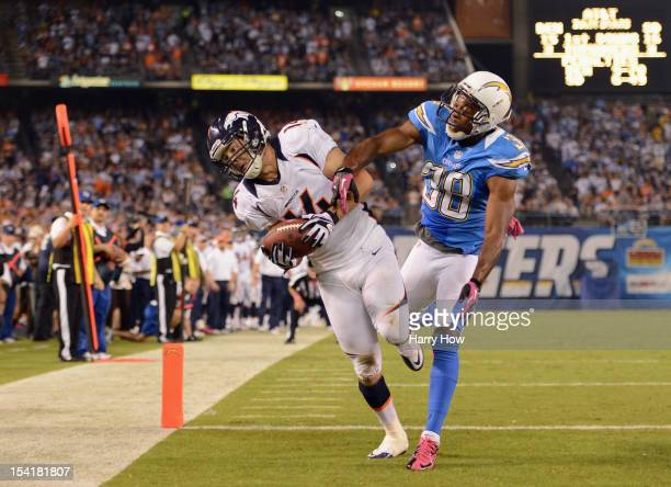 Brandon Stokley of the Denver Broncos maks the catch for a touchdown in the fourth quarter against Marcus Gilchrist of the San Diego Chargers during...