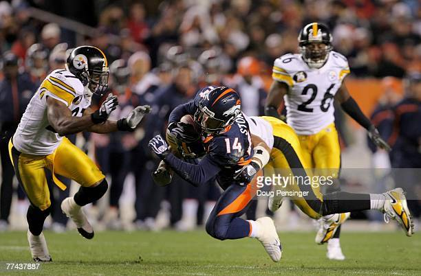 Brandon Stokley of the Denver Broncos picks up a first down with a 17 yard third down reception in the third quarter as James Farrior of the...