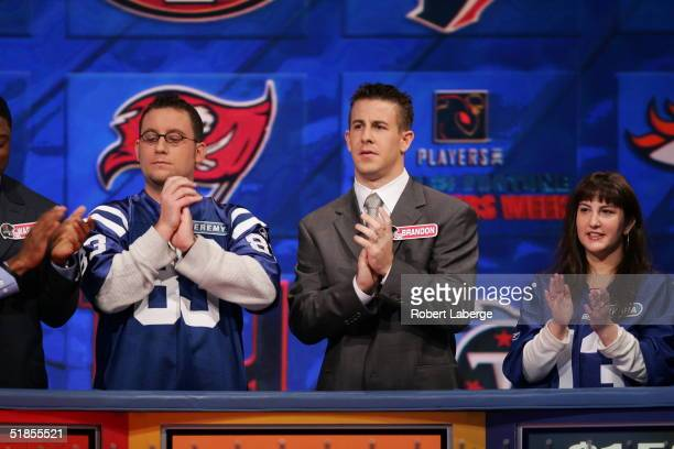 Brandon Stokley of the Indianapolis Colts applauds with his favorite Colts fan during the Wheel of Fortune NFL Players Week taping on December 7 2004...