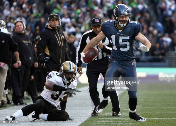 Brandon Stokley of the Seattle Seahawks attempts to avoid a tackle from Jabari Greer of the New Orleans Saints as he runs for fiveyards after the...