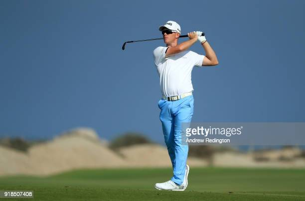 Brandon Stone of Sourh Africa plays his second shot on the par four 4th hole during the first round of the NBO Oman Open at Al Mouj Golf on February...