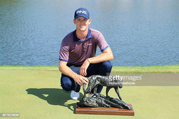 Brandon Stone of South Africa holds the winners trophy following victory during the final round of The Alfred Dunhill Championship at Leopard Creek...