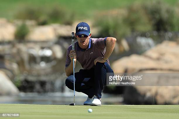 Brandon Stone of South Africa lines up a putt on the 18th green during the final round of the Alfred Dunhill Championship at Leopard Creek Country...