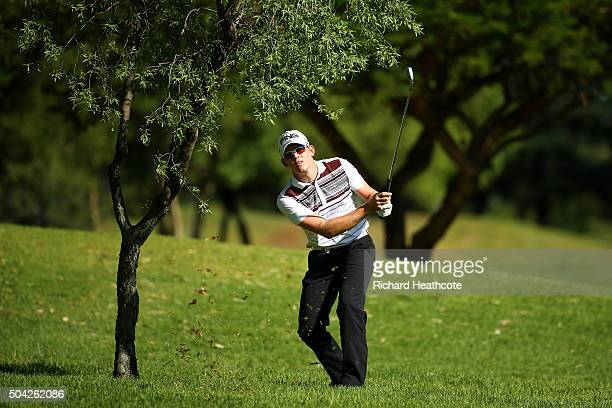 Brandon Stone of South Africa plays from under a tree on the 15th during the resumption of the weather delayed third round of The BMW SA Open at...