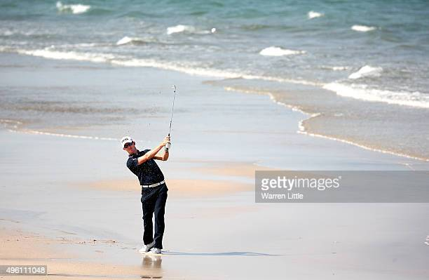 Brandon Stone of South Africa plays his second shot on the 12th hole from the beach during the final round of the NBO Golf Classic Grand Final at the...