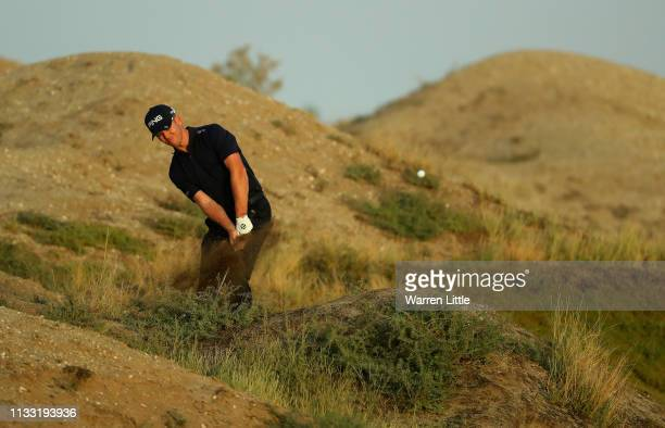 Brandon Stone of South Africa plays his second shot out of the sand on the third hole during the third round of the Oman Open at Al Mouj Golf on...