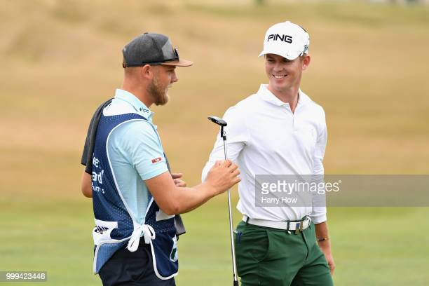 Brandon Stone of South Africa reacts to his birdie putt on hole one with his caddie during day four of the Aberdeen Standard Investments Scottish...