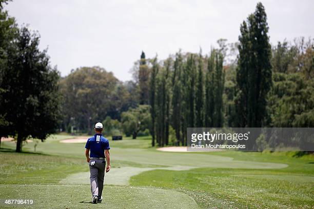 Brandon Stone of South Africa walks down the fairway after he hits his tee shot on the 3rd hole during Day Three of the Joburg Open at Royal...