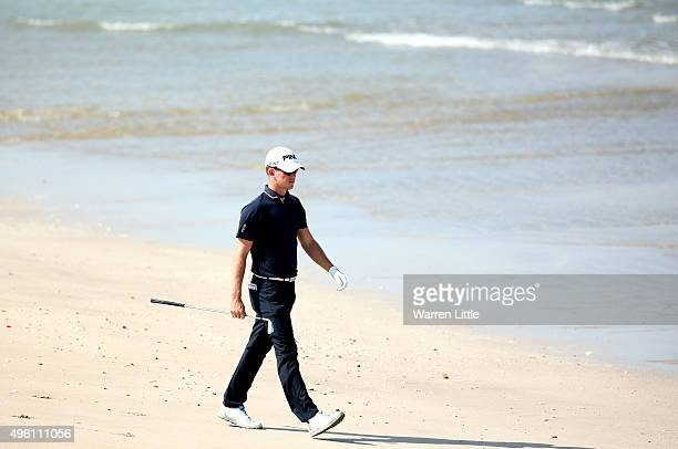 Brandon Stone of South Africa walks to play his second shot on the 12th hole from the beach during the final round of the NBO Golf Classic Grand...