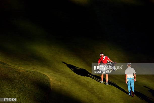 Brandon Stone of South Africa walks with his caddie Basile Dalberto during the third round of European Tour qualifying school final stage at PGA...