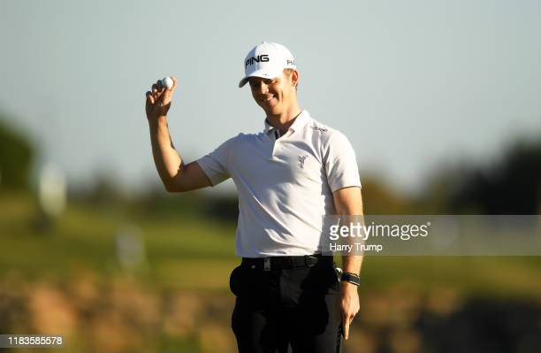 Brandon Stone of South Africa waves to the crowd on the 18th green during Day Three of the Portugal Masters at Dom Pedro Victoria Golf Course on...