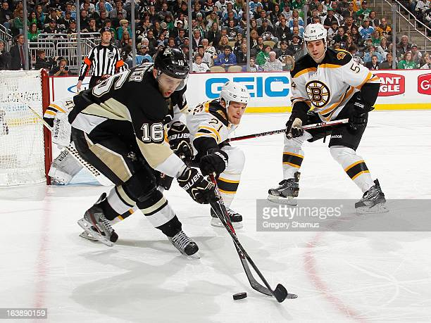 Brandon Sutter of the Pittsburgh Penguins battles for the puck against Andrew Ference of the Boston Bruins on March 17, 2013 at Consol Energy Center...